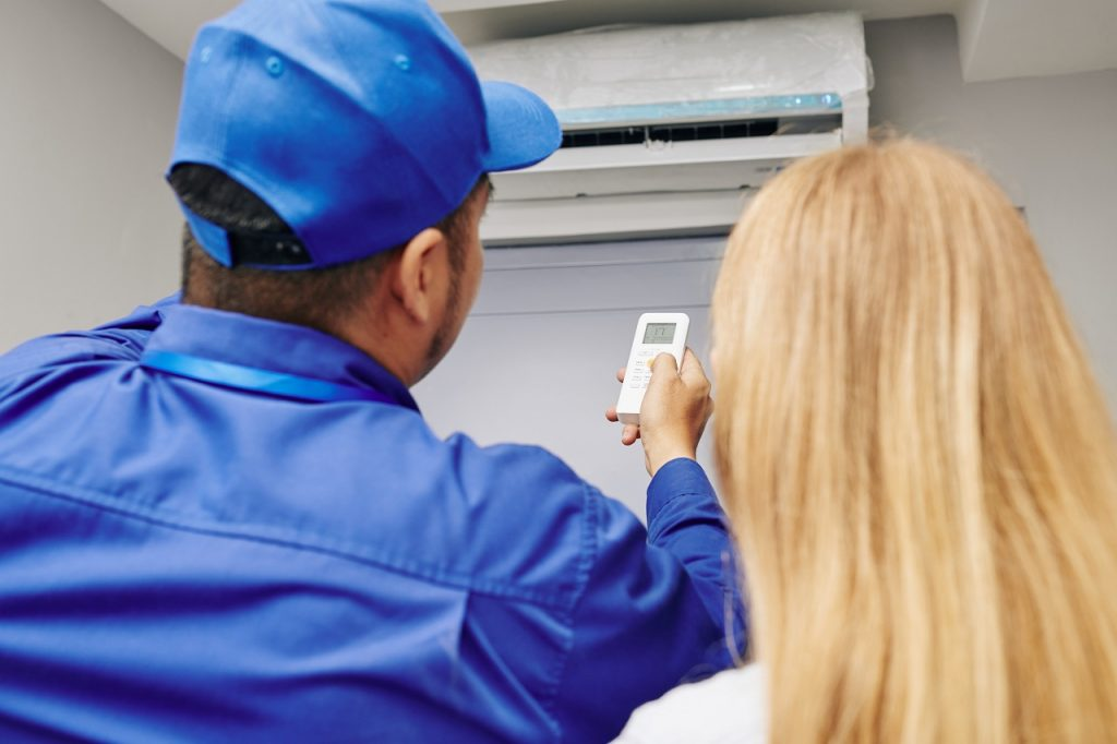 Service worker maintenance on aircon at home